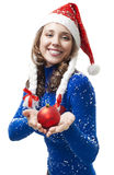 Woman in New year costume give red ball Stock Photography