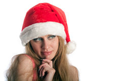 The woman in a New Year's cap Royalty Free Stock Images