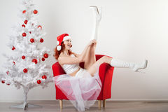 Woman in a New Year's costume Stock Photo