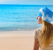 Woman in New Year's Santa-Klaus cap on background of ocean. Stock Photos