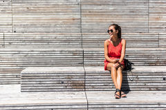 Woman in New York relaxing on bench on High Line stock photos