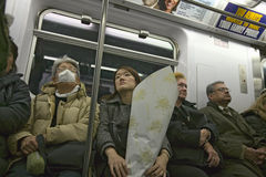Woman on New York Subway system with mask over her face to prevent disease, New York Stock Image