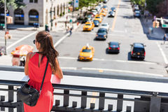 Woman in New York watching street from High Line. In summer wearing red dress and crossbody fashion purse or small bag. People in Manhattan, New York City, USA royalty free stock photos