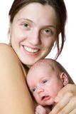 Woman with newborn baby Stock Image