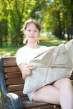 Woman with newspaper Stock Photography