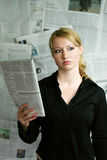 woman with newspaper stock photos