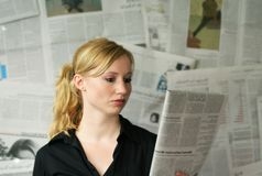 Woman with newspaper Royalty Free Stock Photo