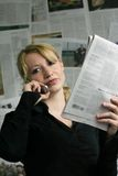 Woman with newspaper Royalty Free Stock Photography