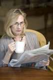 Woman with newspaper Royalty Free Stock Image