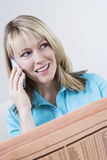 Woman With Newspaper On Call Royalty Free Stock Images