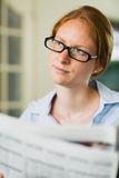Woman with a Newspaper Stock Image