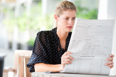 Woman with Newspapers Stock Photos