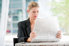 Woman with Newspapers Stock Images