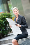 Woman with Newspapers Royalty Free Stock Photography