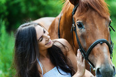 Woman next horse Stock Photography