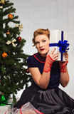 Woman next to Christmas tree Royalty Free Stock Image