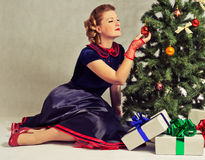 Woman next to Christmas tree Royalty Free Stock Images