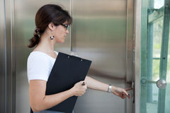 Woman next to the elevator Royalty Free Stock Photography