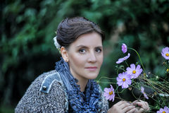 Woman next to the flowers Stock Photography