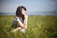 Woman next to lake Stock Photo