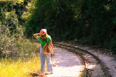 Woman mesmerizing on the rail tracks stock photos