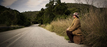 Woman next to the road Royalty Free Stock Photo