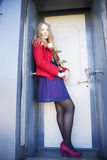 Woman next to stain door with rose Stock Photography