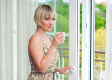 Woman next to window in the morning Royalty Free Stock Photo