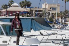 Woman next to the yachts in the marina Stock Photo