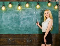 Woman with nice buttocks teaching mathematics. teacher concept. Lady teacher in short skirt explaining formula. Teacher of mathematics writing on chalkboard stock images