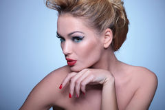 Woman with nice make up and hairstyle looking away Royalty Free Stock Photography