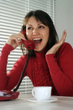 Woman nice with a phone  and a cup Royalty Free Stock Photography
