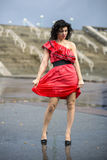Woman in nice soaking wet dress Stock Photography