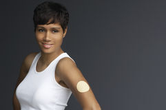 Woman With Nicotine Patch On Arm Stock Photography
