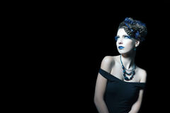 Woman at night with blue makeup Royalty Free Stock Photography