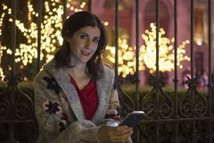 Woman in night christmas scene looking at view Royalty Free Stock Photo