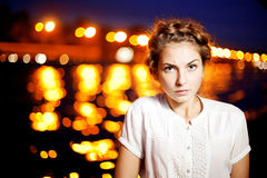 Woman and night city ligthts Royalty Free Stock Photography