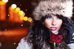 Woman in night city with rose. Royalty Free Stock Photo