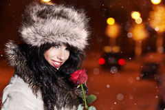 Woman in night city with rose. Royalty Free Stock Image