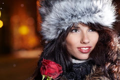 Woman in night city with rose. Stock Image