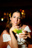Woman at night club toasting with cocktail drink Royalty Free Stock Photos
