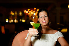 Woman at night club toasting with cocktail drink Stock Image