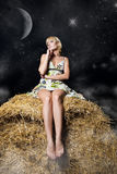 Woman at night field Stock Photography