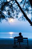 Woman at night with the moon on the Beach Stock Image