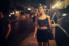 Woman on a night out. Woman walking on the street on a night out Royalty Free Stock Photo