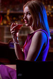 Woman in nightclub Stock Images