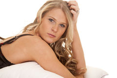 Woman nightgown black and red lay head up serious Royalty Free Stock Photography