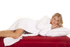 Woman nightgown white robe look hands under head Stock Photos