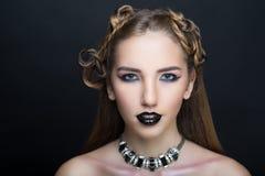 Woman nightmare make up. Woman nightmare. Creative dark make-up, conceptual idea for Halloween. Eerie beauty monster turning into black vampire, volume spikes Stock Photo