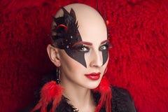 Woman nightmare make up. Woman nightmare. Creative dark make-up, conceptual idea for Halloween. Eerie nightmare turning into a black vampire, volume spikes body Stock Photos